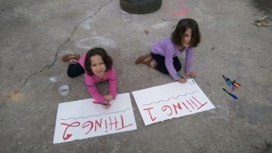 Abbi & Ceci making their parade signs.